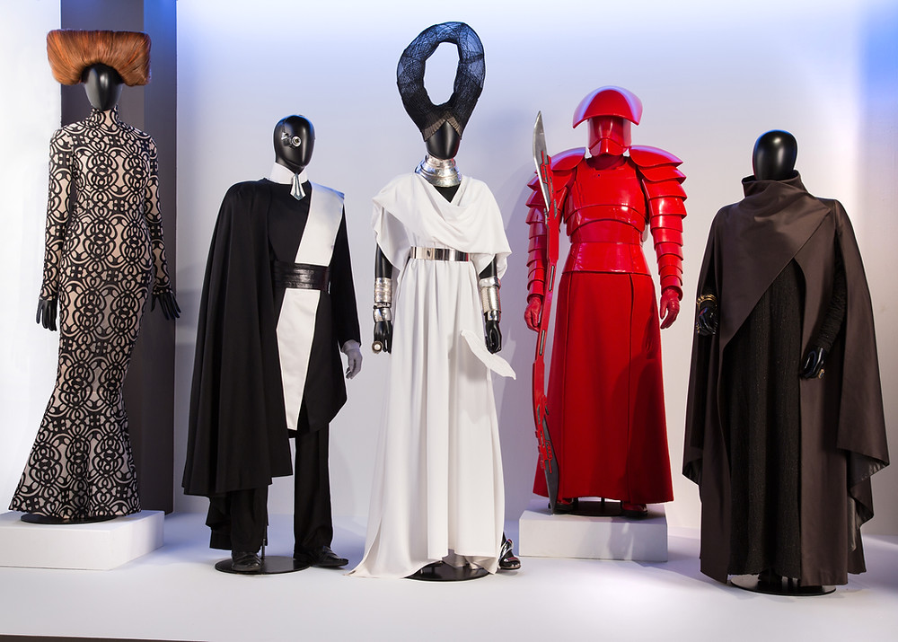"""Star Wars: The Last Jedi"" costumes by Michael Kaplan. (L to R) Costumes worn by actors: Lily Cole as Party Girl, Canto Bight Guest - Male, Canto Bight Guest - Female, Elite Praetorian Guard, Carrie Fisher as General Leia Organa"