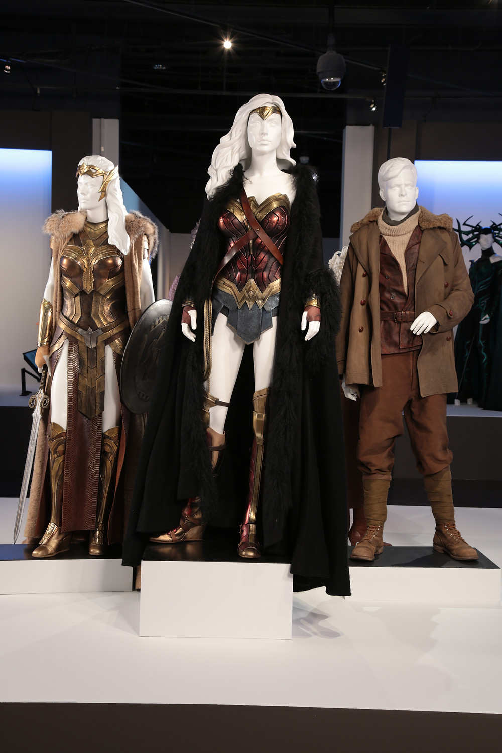 "Wonder Woman"" costumes by Lindy Hemming. (L to R) Costumes worn by actors: Connie Nielsen as Hippolyta, Gal Gadot as Diana Prince/Wonder Woman, Chris Pine as Steve Trevor."
