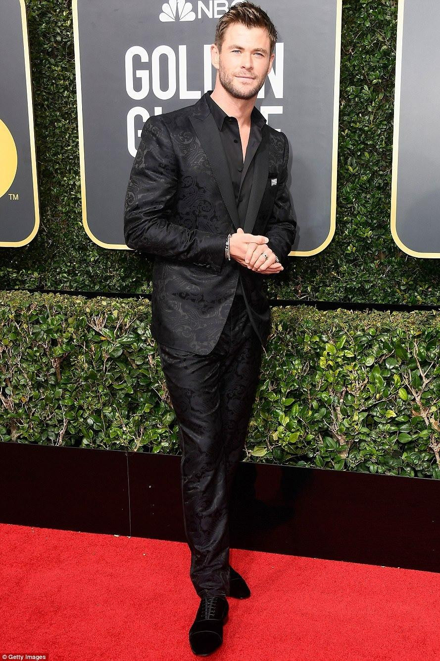 Hemsworth joined the Time's Up moment on the Golden Globes red carpet, wearing a black brocade tuxedo from Etro. Styled by Samantha McMillen.