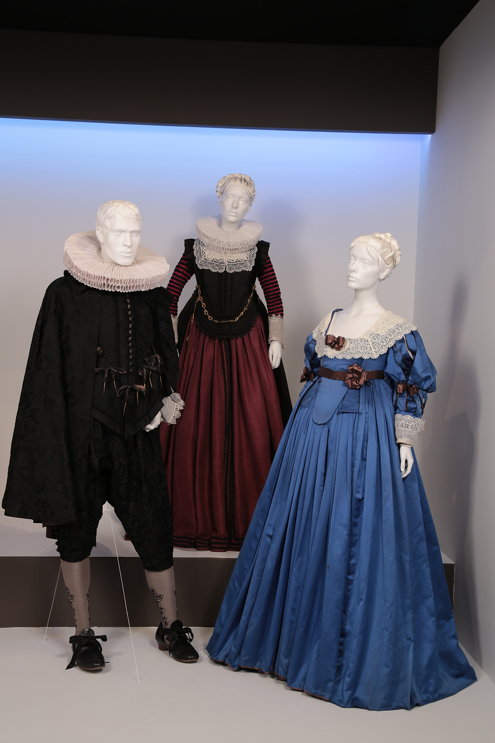 """Tulip Fever"" costumes by Michael O'Connor. (L to R) Costumes worn by actors: Christoph Waltz as Cornelis Sandvoort, Alicia Vikander as Sophia Sandvoort, Alicia Vikander as Sophia Sandvoort"