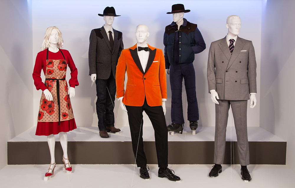 """Kingsman: The Golden Circle"" costumes by Arianne Phillips. (L to R) Costumes worn by actors: Julianne Moore as Poppy, Pedro Pasqual as Agent Whiskey, Taron Egerton as Eggsy, Pedro Pasqual as Agent Whiskey, Colin Firth as Harry Hart"