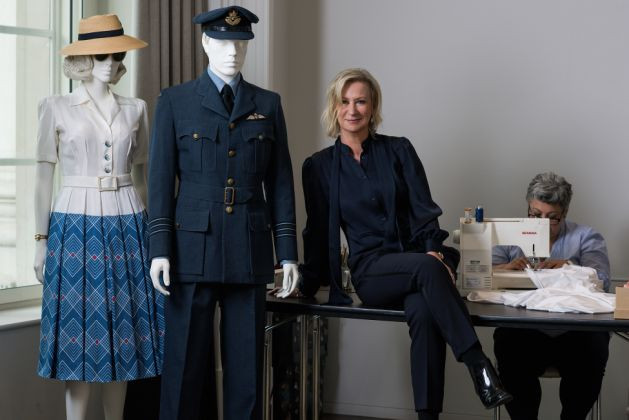Joanna Johnston with costumes she designed for Allied.