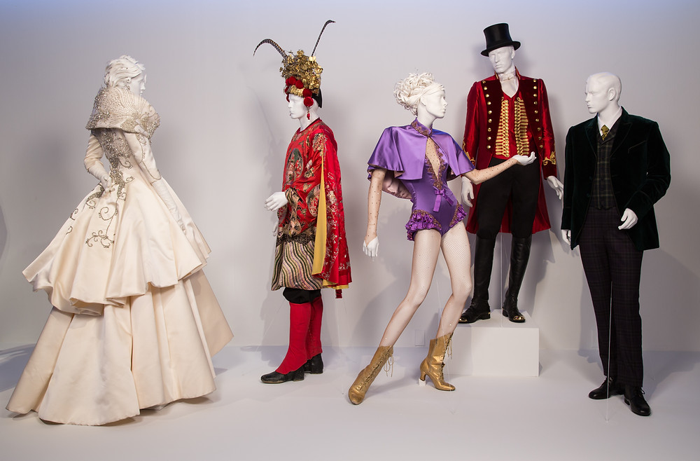 """The Greatest Showman"" costumes by Ellen Mirojnick. (L to R) Costumes worn by actors: Rebecca Ferguson as Jenny Lind, Chinese Dancer, Zendaya as Anne Wheeler, Hugh Jackman as P.T. Barnum, Zac Efron as Phillip Carlyle"
