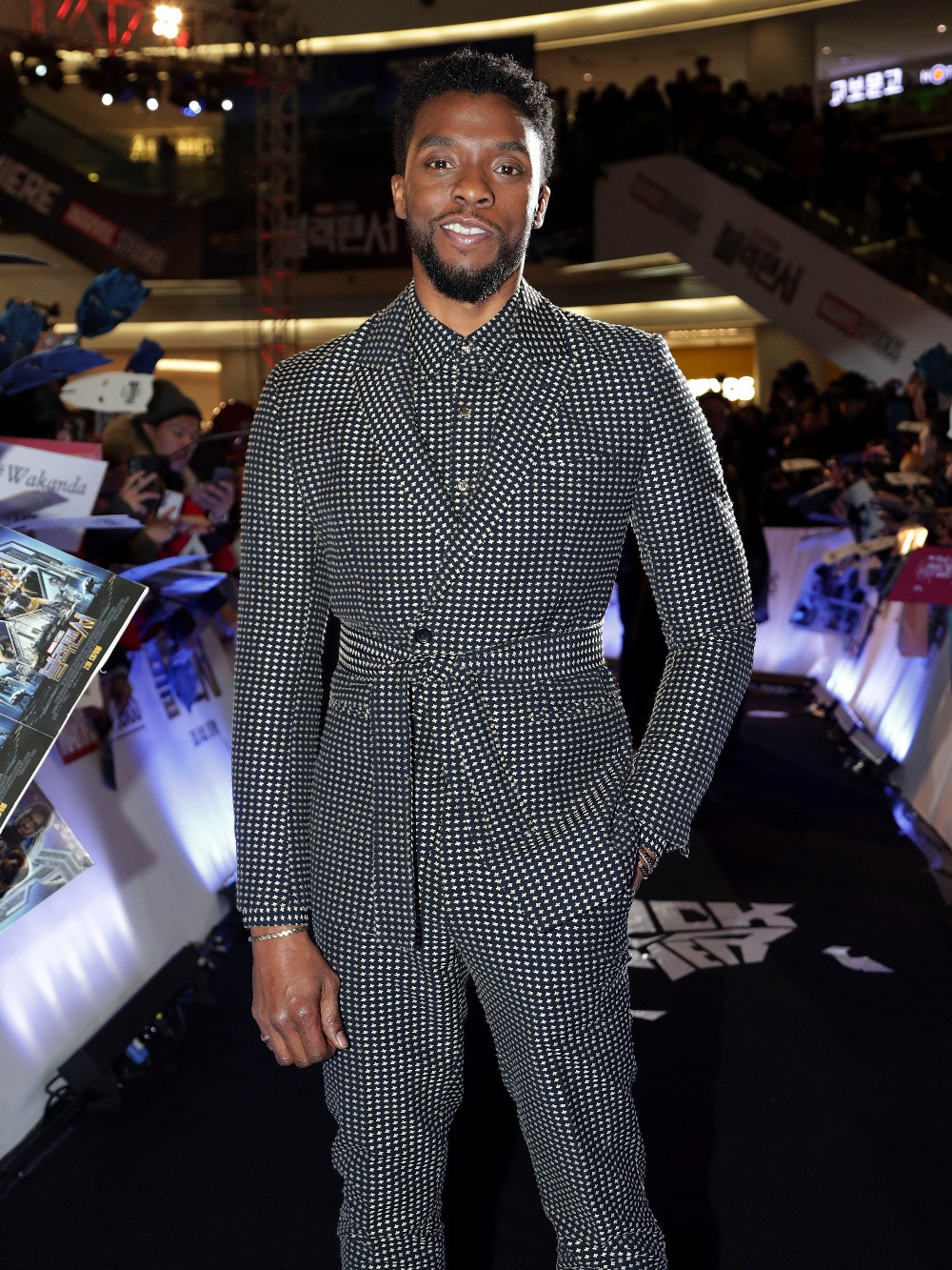 One of Weston's favorite looks that she's dressed Boseman in- this Dzojchen suit for the Black Panther premiere in Seoul, South Korea.