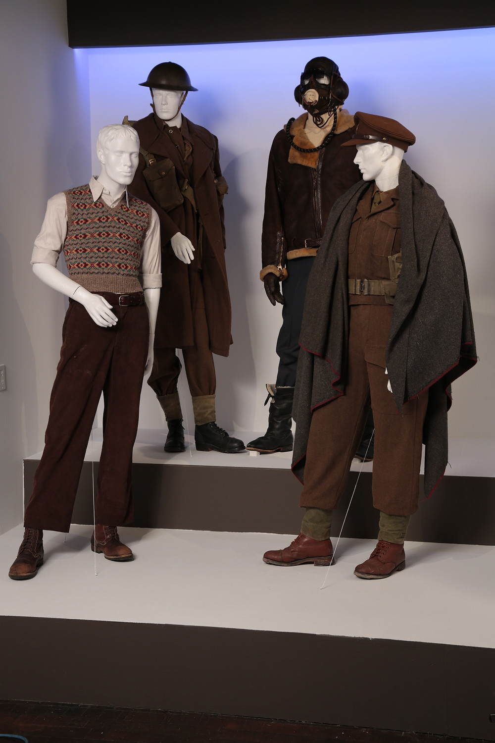 """Dunkirk"" costumes by Jeffrey Kurland. (L to R) Costumes worn by actors: Cillian Murphy as Shivering Soldier, Finn Whitehead as Tommy, Tom Hardy as Farrier, Barry Keoghan as George"