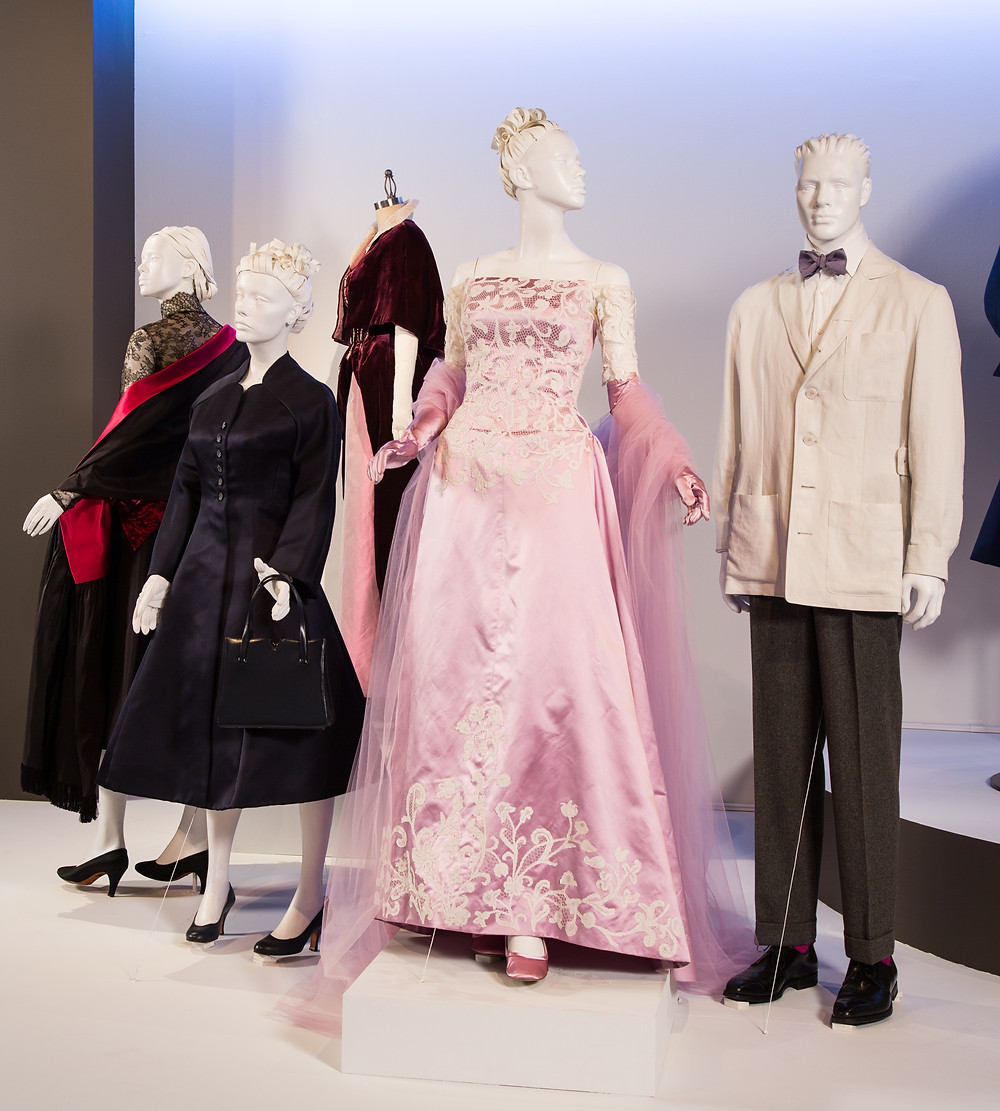 """Phantom Thread"" costumes by Mark Bridges, Academy Award Winner for Costume Design. (L to R) Costumes worn by actors: Vicky Krieps as Alma, Lesley Manville as Cyril Woodcock, Vicky Krieps as Alma, Daniel Day-Lewis as Reynolds Woodcock"