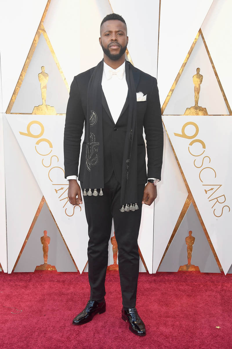 "Winston Duke posted on his Instagram, ""Feeling like a BILLION bucks!"" dressed in Etro at the Oscars. Styled by Jenny Ricker."