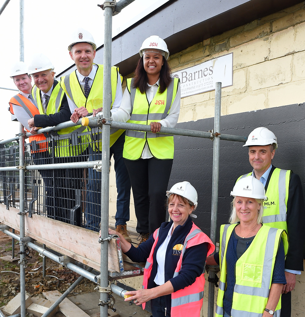 Maureen Reynel founder of FIND with representatives from the construction companies helping build the new home for FIND