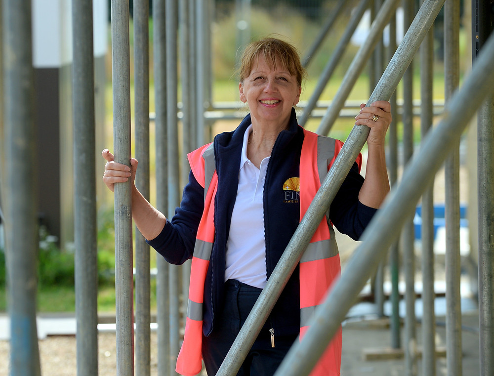 Maureen Reynel MBE and founder of FIND standing outside the new foodbank at the topping out ceremony