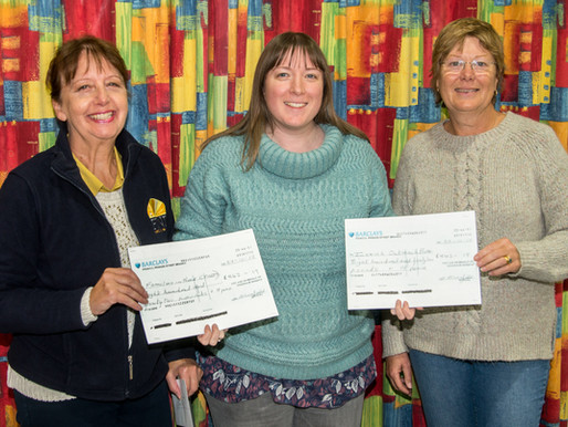 Community Choir Present Cheque to FIND at Charity Concert