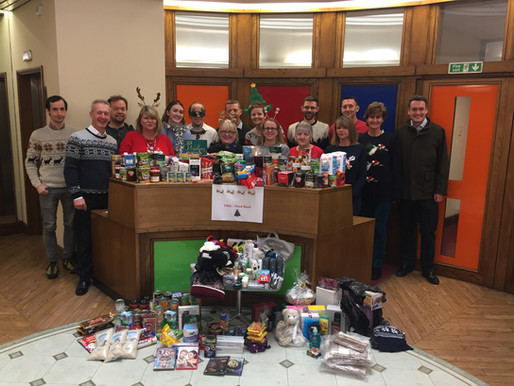 Local businesses join forces to spread festive cheer with food bank donation