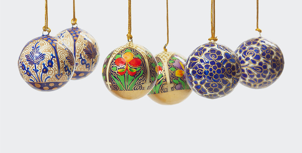 Multi coloured ethically sourced Christmas decorations available at Artisan Homeware.