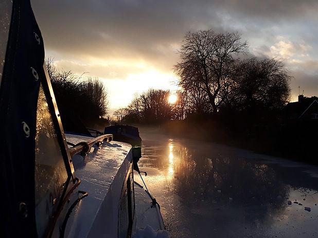 Sunset_water_canal_boatlife_orange.jpg