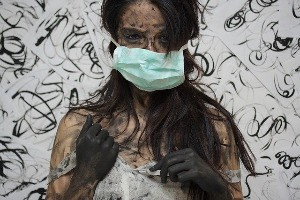 sick girl wearing surgical mask