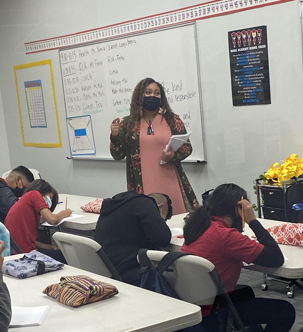 Miss Fatai teaching 7th grade