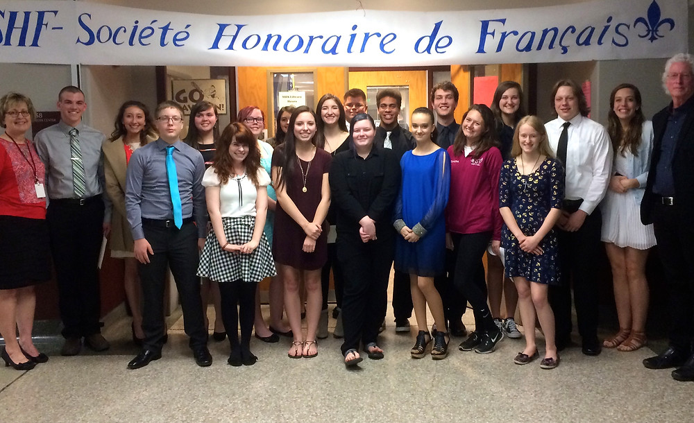 Members of the French Honor Society with Ms. Herman on the very left and Dr. Mackenzie on the very  right of the image.