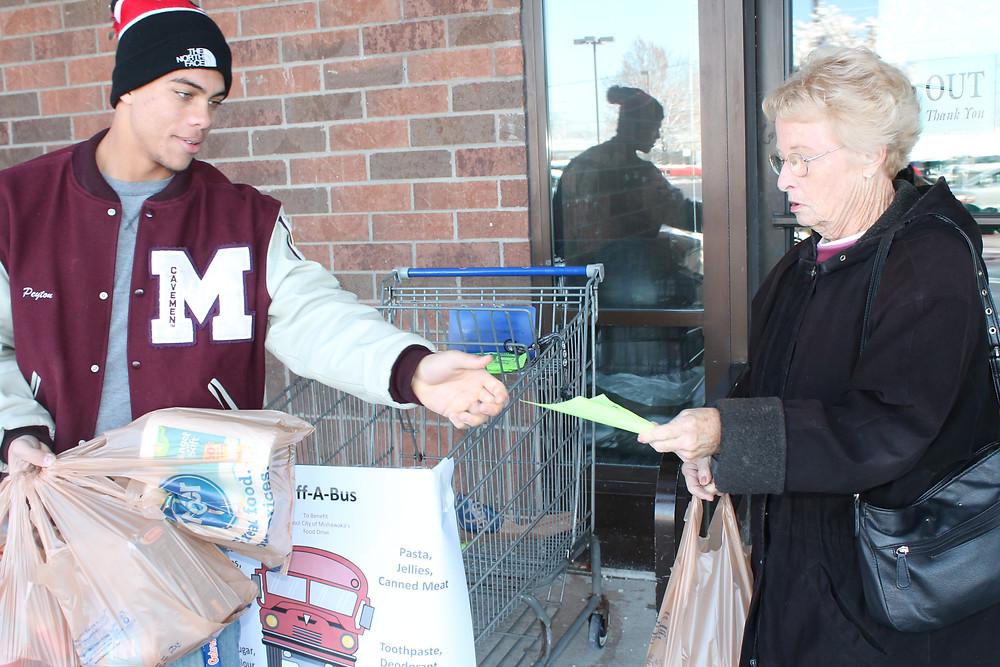 Peyton Marshall helps collect a donation