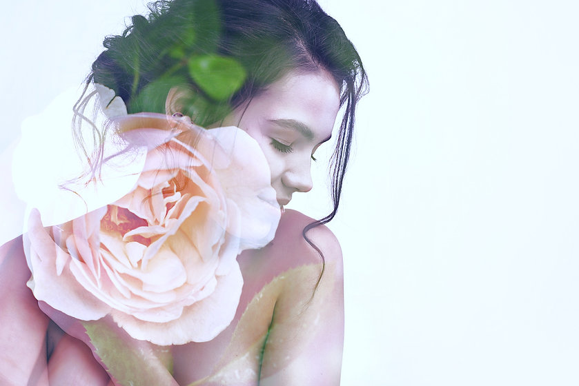 Double exposure portrait of young pretty woman combined with photograph of beautiful rose flower. Co