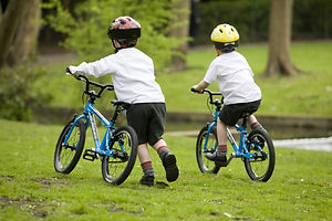 Children-riding-away-e1415381010504.jpg