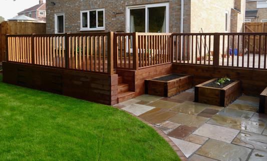 Raised-decking-with-storage-garden-desig