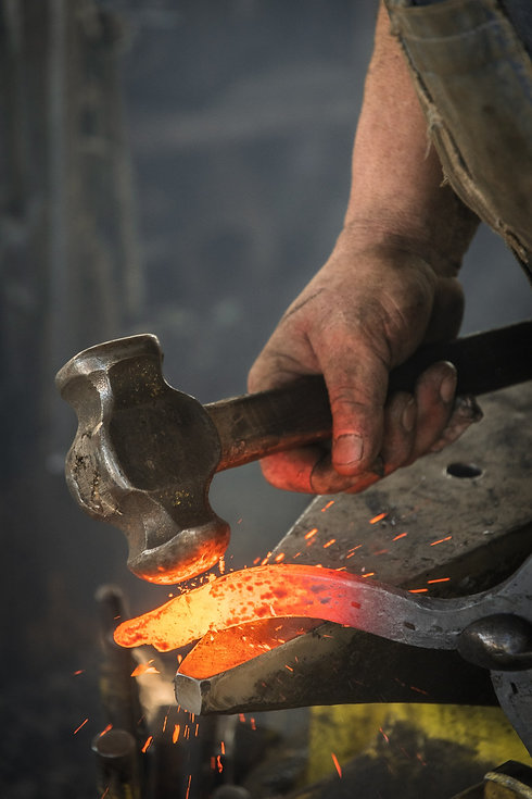 man-forging-metal-3680094.jpg