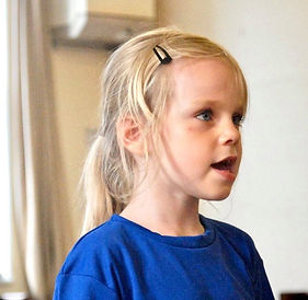 young child having a singing lesson