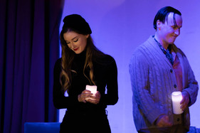 mimi and rodolfo hold candles (1 of 1).j