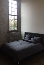 Single bed, brick wall 2 croped.jpg
