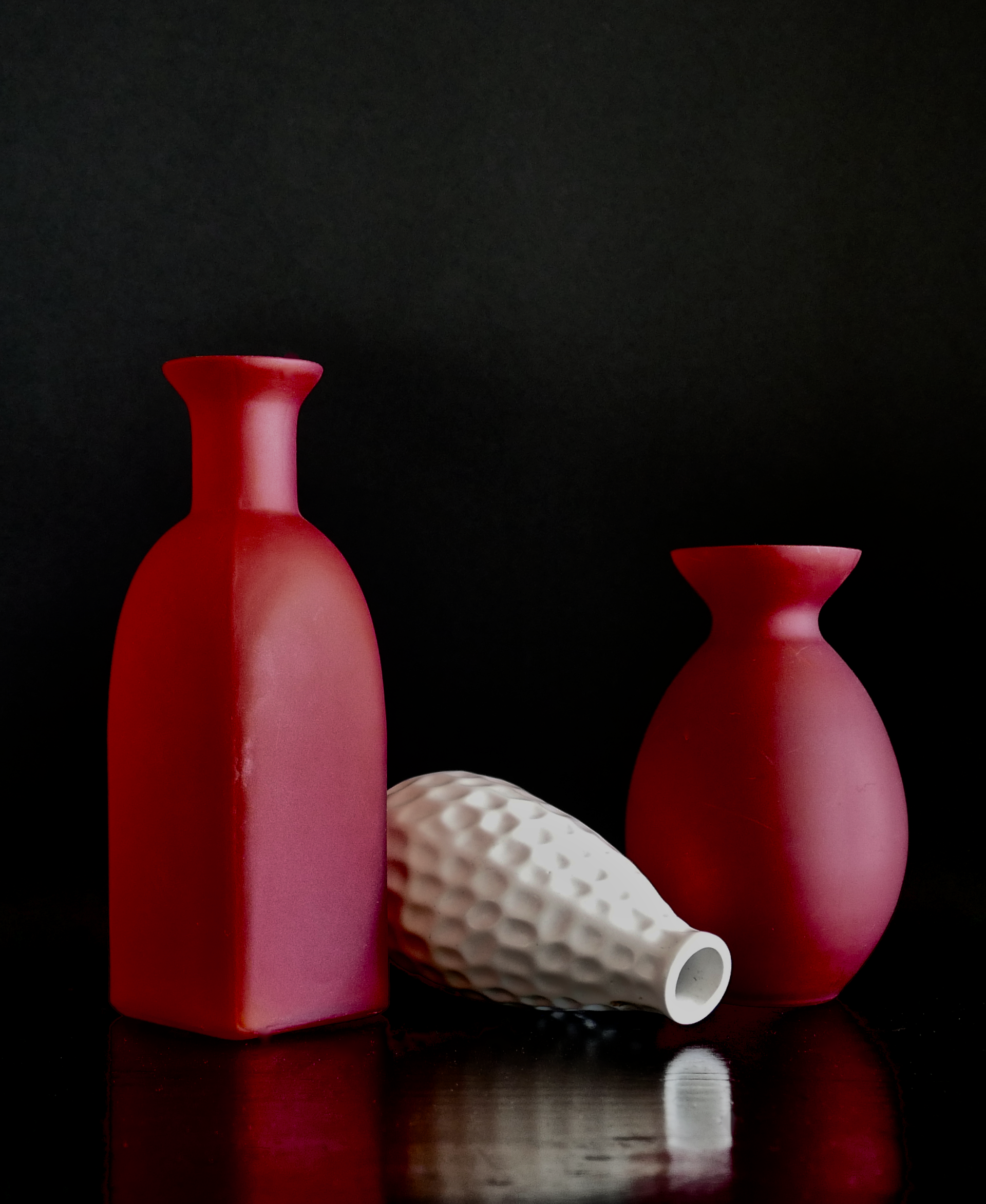 Red Vessels and White Vase