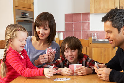 Family Playing Cards In Kitchen.jpg