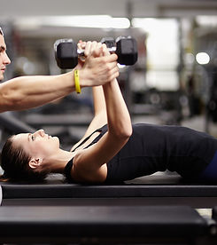 Personal%20trainer%20helping%20woman%20w