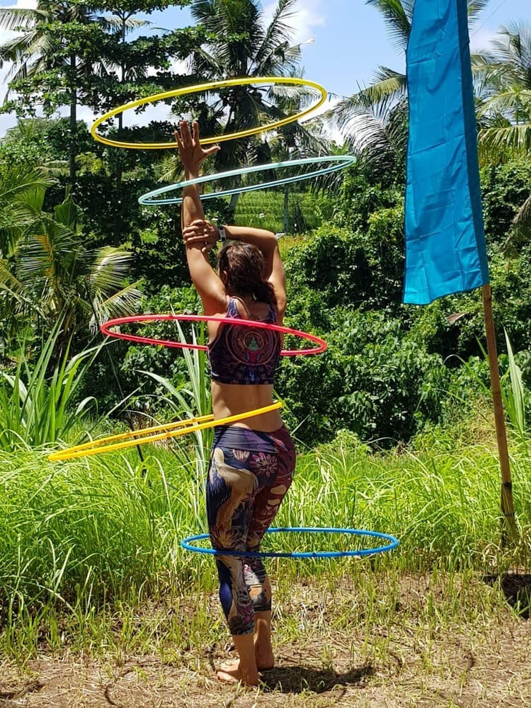 Lisa Hula Hooping in the nature in Bali with multiply hula hoops