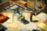 2-man-on-construction-site-during-daytim