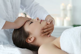 lying-woman-receiving-massage-craniosacr