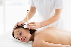 woman-receiving-ear-candle-treatment-fro
