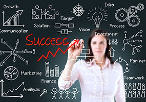 Young business woman writing success by
