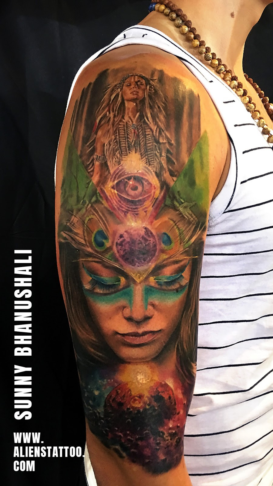 Colourful women's portrait tattoo with feathers made at Aliens Tattoo Studio