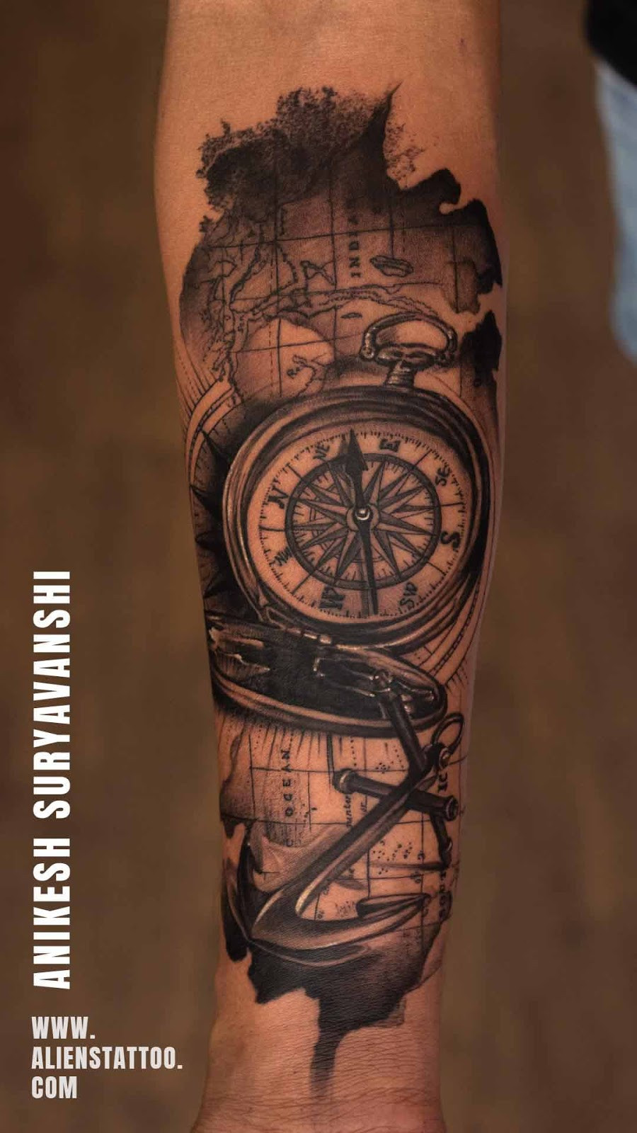 Map, compass, and traveller's instruments tattoo made at Aliens Tattoo Studio