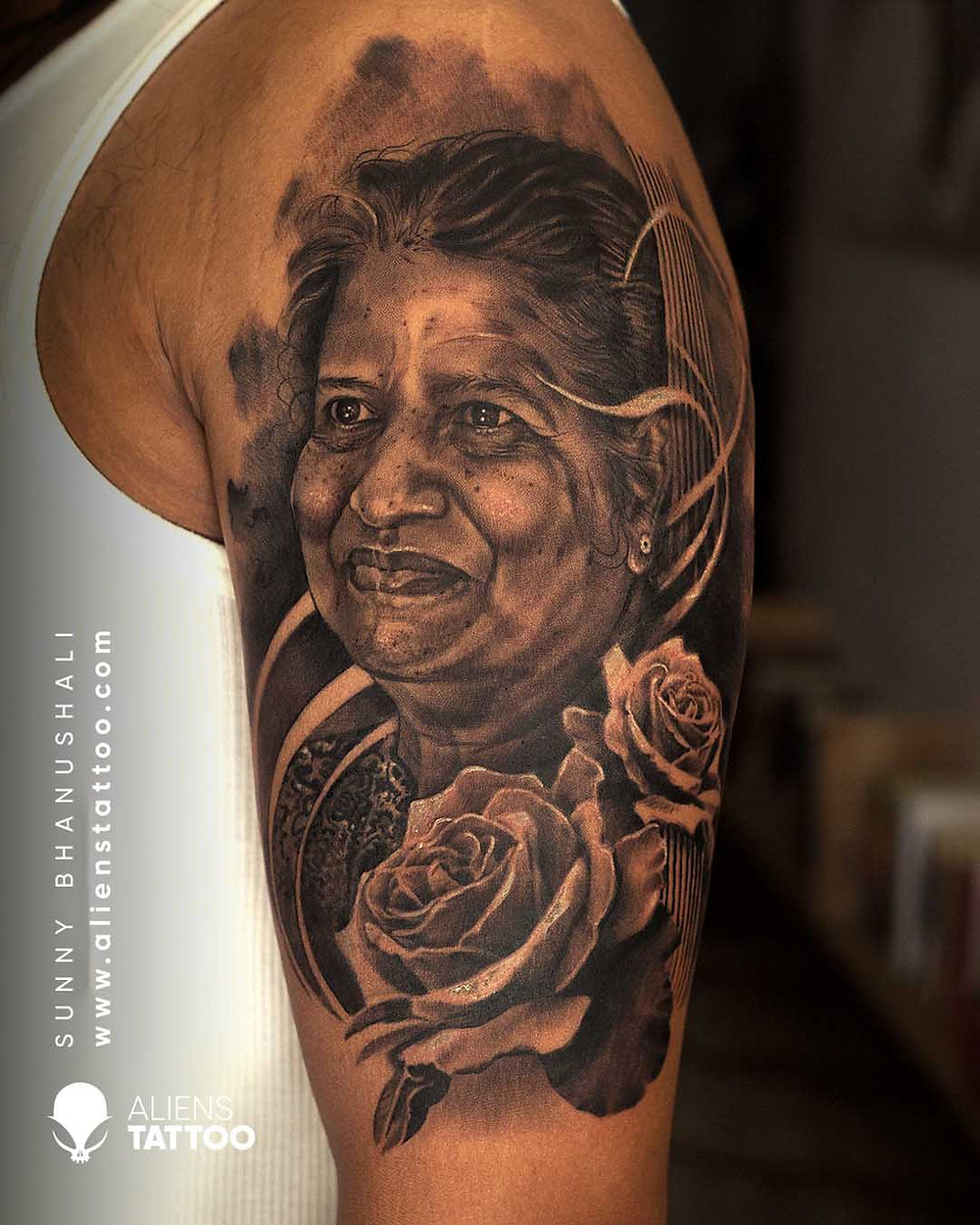 Black and white portrait tattoo with roses made at Aliens Tattoos India