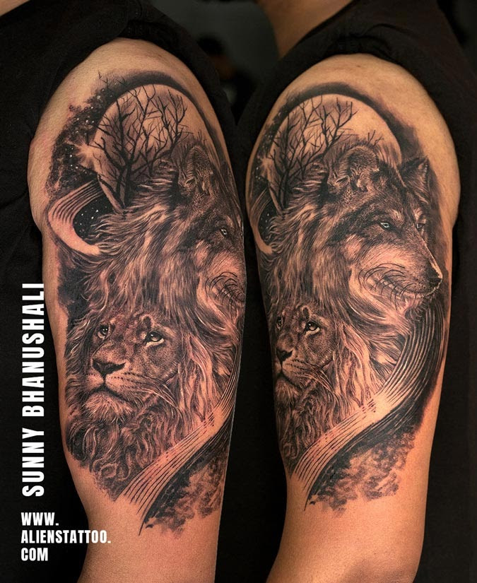 Wolf and lion at night tattoo made at Aliens Tattoo Studio India