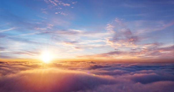 Beautiful sunset sky above clouds with d