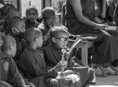Young Monk Dark Glasses