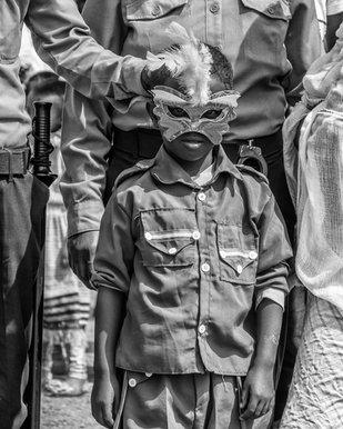 Boy with Timket Mask