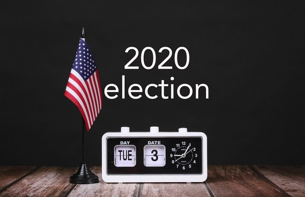 """The American people shared their voice in the 2020 election on Tuesday, November 3rd.""""American flag and vintage clock with calendar showing 2020 election date"""" by wuestenigel is licensed under CC BY 2.0"""