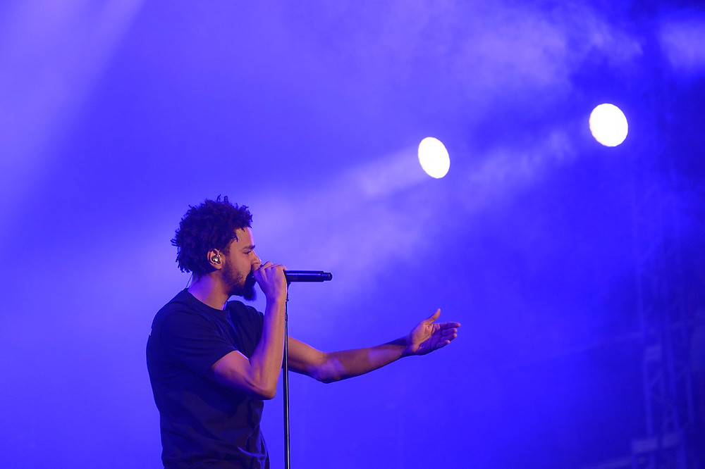 """J. Cole's new album tops charts. """"J. Cole"""" by Pemberton Music Festival is licensed under CC BY-NC 2.0."""