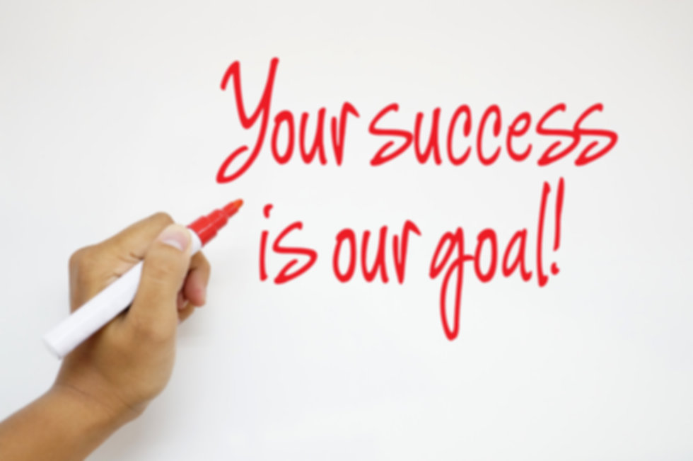 Your Success Is Our Goal! sign on whiteb