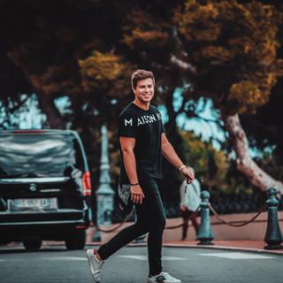 Josh Stanley Monaco walking across the r
