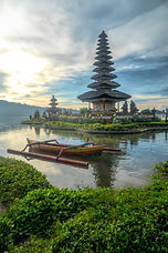 canoe-on-body-of-water-with-pagoda-backg