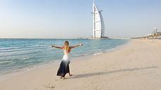 photography-of-woman-walking-on-seashore