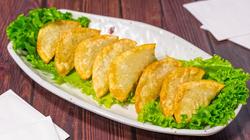 A1. Homemade Fried Dumplings (6 Pieces) 군만두